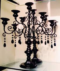 I have been looking for black candelabras forever! And finally found them  at Michaels. They are out with the halloween decor.