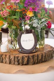 The bride and her family planted wildflowers in the spring and used the  brilliant blooms in stunning centerpieces. Assembled in simple mason jars  placed on ...