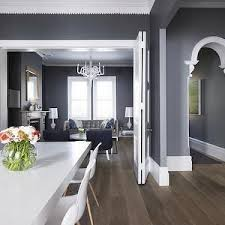gray and white dining room ideas. greg natale: dark gray wall color paired with crisp white crown molding and hardwood floors. jonathan \u2026 dining room ideas