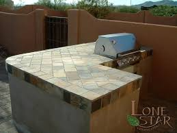 outdoor kitchen tile countertop ideas. this barbecue island has a large slate tile countertop in cave creek, az. - outdoor kitchen ideas e