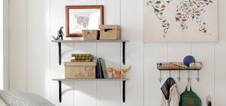 wall mounted shelves holding small storage boxes and decor