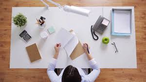 office desk work. Business, People And Work Concept - Businesswoman With Papers Working At Office Desk