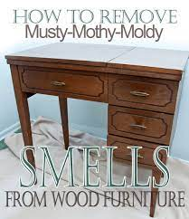 mothy moldy smells from wood furniture