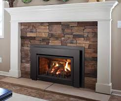 Regency U31 Gas Fireplace Insert with brown brick surround and white mantel