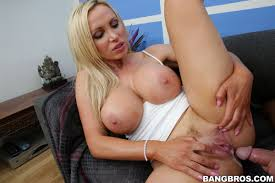 Nikki Benz rides dick on the couch in a white tank top BangBros.