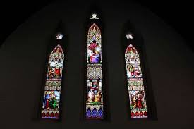 19th century stained glass windows at all saints church undergoing restoration