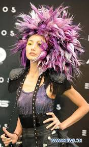 a model presents a hairstyle creation during a hairstyle show held in the far east fashion pavilion at the flora expo in taipei southeast china s taiwan