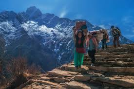 a journey to mount everest base the planet d porters carry heavy loads up and down to mount everest base camp