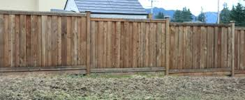 installing a fence hanging rails between posts installing wood fence rails installing wood fence on uneven ground