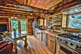 single wall log cabin kitchen with wood countertops
