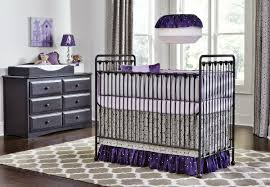 quatrefoil nursery rug with grey and purple crib bedding by pine