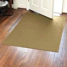 rugs that trap dirt and water good idea a catcher rug designed to fit under most front doors so