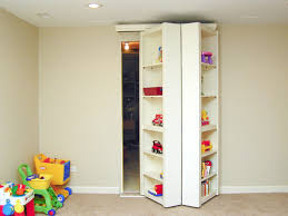 screet and room behind wood toy storage cabinet with white interior color in the basement after remodel ideas
