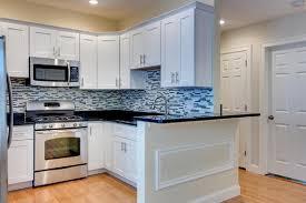 kitchen white maple shaker with black granite countertops