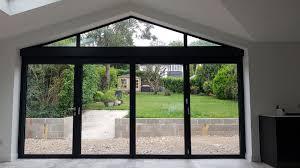 schuco bifolding doors and aluminium gable window in purley aspire bifolds home improvements surrey