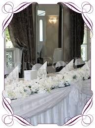 white table garland bridal table decoration for hire to melbourne and surrounds