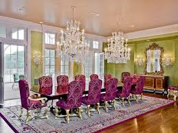 rectangular crystal chandelier dining room with extra large carpet and using purple chairs plus antique wall mirrors