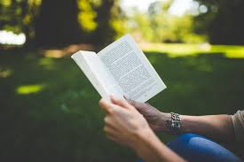 Image result for a person reading a book