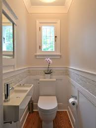 Powder Room Design Ideas example of a small classic powder room design in ottawa with a wall mount sink