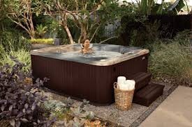 Complete your outdoor hot tub landscape design with these creative ideas.