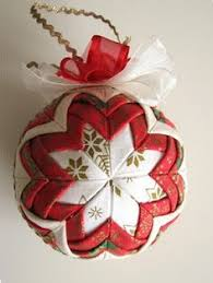 Quilt ornament tutorial ~ This tutorial is in Polish, but the pictures are  clear! Some creative folding, pins, scraps and a styrofoam ball is all this  ...