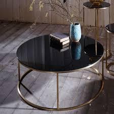 black coffee table. Slimline Black Glass Circular Coffee Table With Brass Legs K