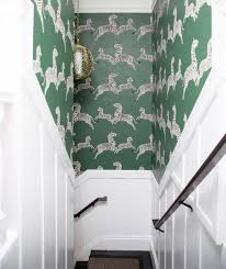 Amazing Staircase Features Upper Part Of Walls Clad In Serengeti Green Scalamandre  Zebra Wallpaper And Lower Walls Clad In Board And Batten Trim Illuminated  ...
