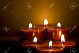subdued lighting. Red Church Candles Burning In Subdued Lighting Stock Photo - 8591774 R