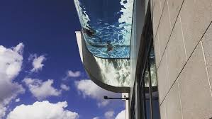 clear bottom swimming pool hangs over building s edge 40 stories aboveground architectural digest