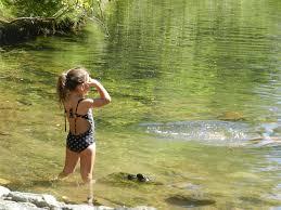 Little girl in shallow water