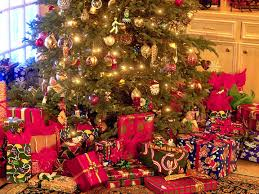 A Christmas tree with presents underneath it.
