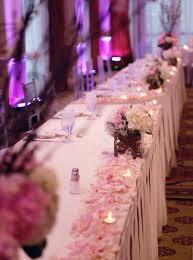 hyatt huntington beach wedding by john park head table pink and white centerpiece