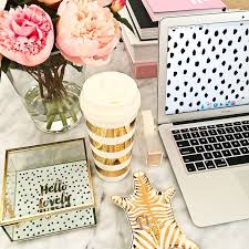 neutral office decor. pink peonies and gold tray with laptop neutral office decor