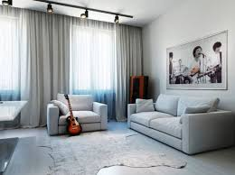 track lighting living room. Track Lighting Living Room With White Upholstery Sofa Frmed Picture Square Table And Unusual Rug G
