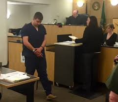 alexandru v sambra 18 makes a first appearance in clark county superior court on tuesday in connection with a shooting at the grand central fred meyer