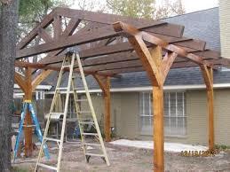 pergola construction. closer view of trusses on pergola construction e