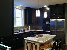 black kitchen cabinets in small kitchen photo - 1