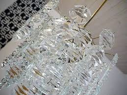 stunning mid century crystal three tier chandelier with 115 sculptural faceted crystals and a