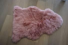 dusky ping sheepskin rug on floor