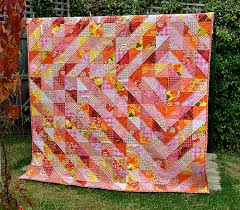 Trending Triangles: Half Square Triangle Roundup | WeAllSew & Patch Andi arranged half square triangle blocks to make a beautiful diamond  patterned quilt. Although there are lots of warm colors in this patchwork  quilt, ... Adamdwight.com