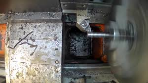 metal milling machine. cnc milling machine produces metal detail on factory. true working process.