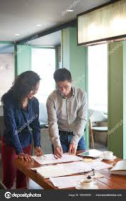 Vietnamese Business People Analyzing Charts Graphs Table
