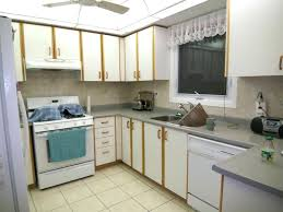 painted laminate kitchen cabinets how to paint laminate cabinets without sanding painting laminate kitchen cabinets grey
