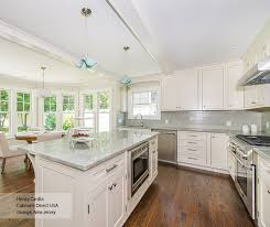 off white l shaped kitchen design with an island