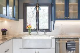 gray granite countertop in blue and white kitchen