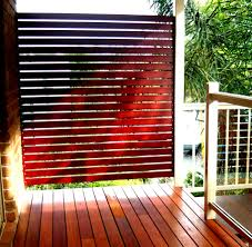 simple wooden privacy screen on decks design featuring varnished wooden lattice as cool additional fences