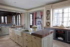 alder wood bright white glass panel door kitchen cabinets long island backsplash subway tile travertine tile countertops sink faucet island lighting