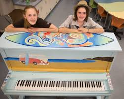 hailey shapiro left a ninth grader at holmes junior high and her sister isabelle a holmes seventh grader proudly show off the piano painted by their