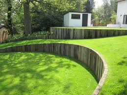 Small Picture Curved timber retaining wall with vertical railway sleepers great
