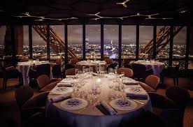 dining with eiffel tower view. view of the city lights, scintillating beneath your feet.to fully enjoy experience, chef has created a unique \ dining with eiffel tower